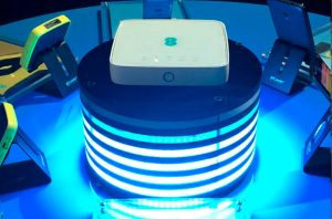 Front view close up of 4GEE home router sitting on top of Cylindrical LED display plinth.